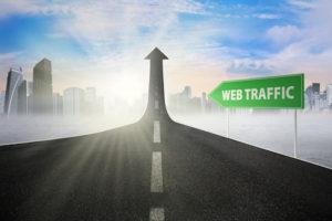 web traffic signpost on climbing road